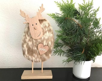 Reindeer made of wood with cowhide