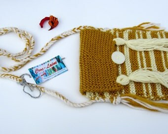 Small bag or clutch in mustard yellow and ecru striped knit with fringe