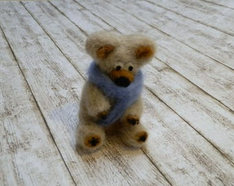 Needle felted bear with scarf.
