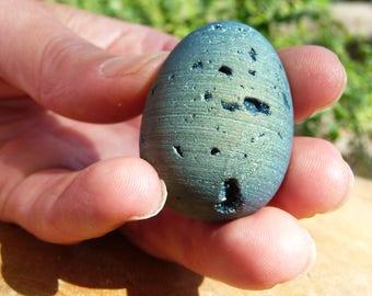 Beautiful titanium coated druzy quartz egg