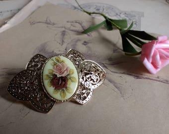 Vintage golden metal barrette with roses cameo center
