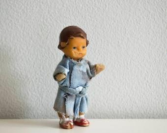 Miniature  doll girl rubber .