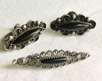 Silver and onyx earrings, brooch