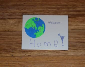 world welcome home card