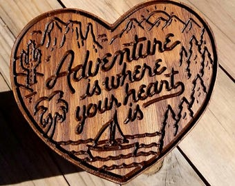 Adventure is where your heart is sign