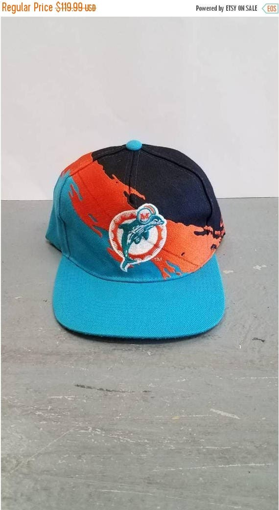 Fall Sale 10% Off RARE Vintage 90 s NFL Miami Dolphins Paint Splash Snapback  Hat By 77c85571c