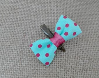 Green fabric bow of Turquoise with fuchsia dots hair clip