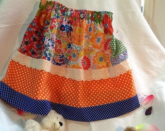 Clothing, Girls Skirt, Elasticised Waist,  3-Tiered, Cream Lace Insert, Bright Orange Floral, Spotted Blue and White Hemline, Frilly