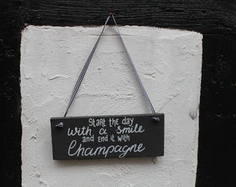 Start the day with a smile and end it with champagne, wooden sign