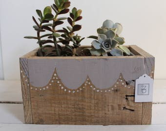 wooden planter made from reclaimed materials