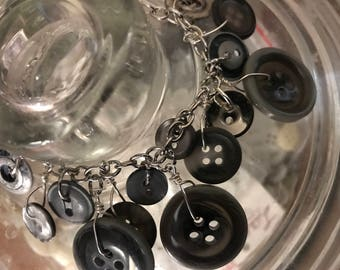 Gray button and wire bracelet