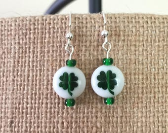 White rounds w/ green shamrock inlays and green glass bead earrings