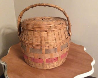 A vintage large wicker picnic basket with lid