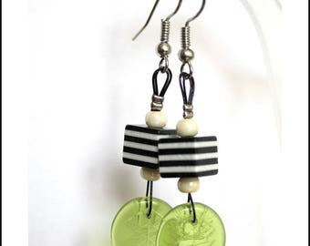 Earrings black cubes and green leaves.