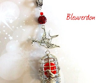 Pregnancy's Bola birdcage swallow and red beads