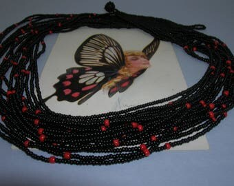 A vintage multi-strand necklace made with seed beads