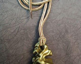 a sculpture Medallion Choker