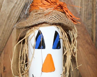 Scarecrow painted wine bottle