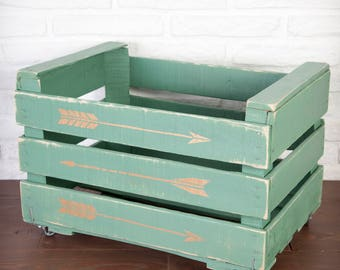 Fruit box restored and painted green with Golden arrows