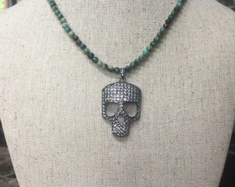 African turquoise with pave skull pendant