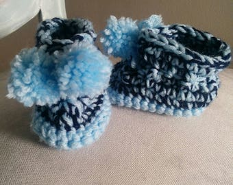 Baby bootie with pom poms