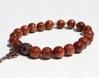 Red Goldstone stretch bracelet with charm