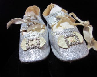 Doll Shoes; Silver colored oil cloth with heels as is