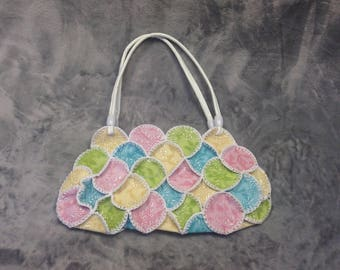 Floral embossed patchwork leather effect bag in white, green, pink, blue and yellow.