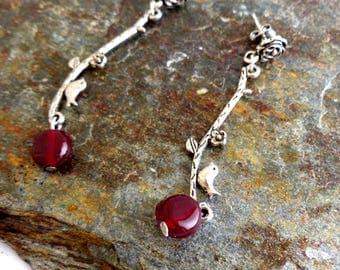 Elegant dangling earrings for a bird on branch and Garnet glass beads