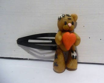Bear with a polymer clay heart hair clip