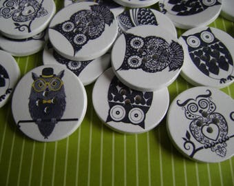 "Black and white wooden ""owls"" buttons"