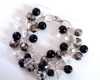 Grey black and transparent beads and silver chain bracelet