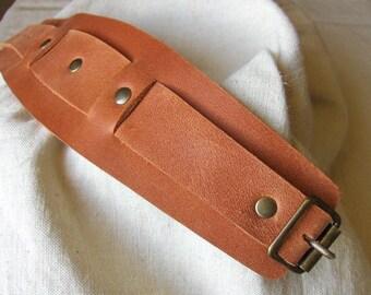 Handmade strength flared orange leather bracelet