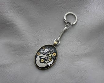 Key-shaped oval Steampunk watch parts and resin