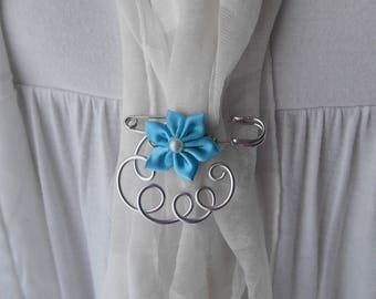 Brooch with turquoise satin flower