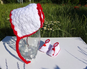Red and white baby booties and hat