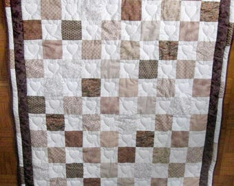 Beige patchwork squares with hearts imprisoned