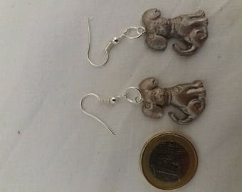 Silver resin earrings depicting a dog.