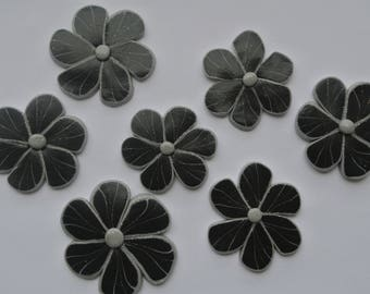 7 pieces of polymer clay shapes flowers, a gray and black glitter