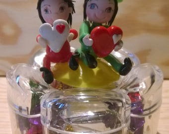 Box candy: couple of cold porcelain ornaments.