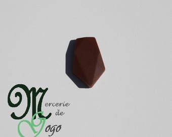 Brown arrow silicone flat bead.