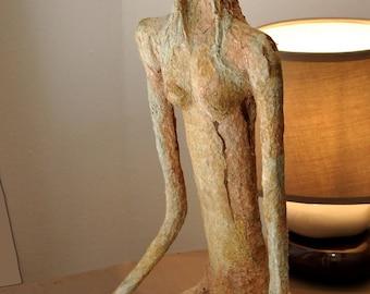 "Paper mache sculpture. Title ""Begging"". Representation of a woman in prayer. Paper mache dyed"