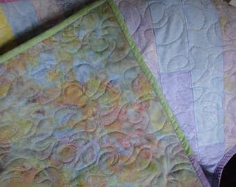 Custom baby quilt of pastel batiks for boy or girl