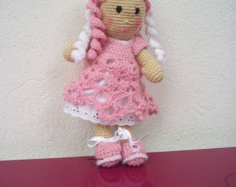 Pink and white wool doll