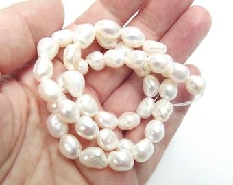 32 perles d'eau douce blanches irrégulières 7-9 mm LAO-574