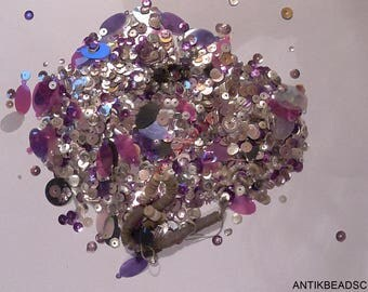 35 grams of antiques sequins and  beads