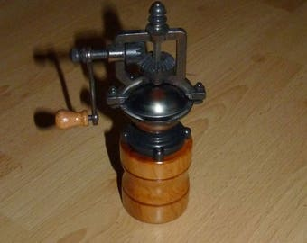 Cherry wood old mechanism spice mill