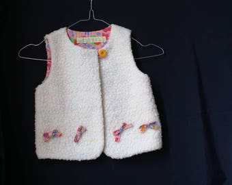 ecru sheep vest inner fruit pink floral background