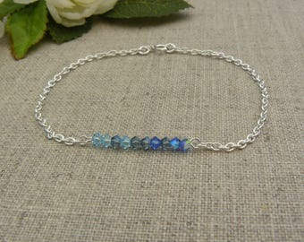 925 sterling silver bracelet, blue swarovski faceted beads.