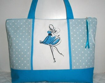 """embroidered """"Woman in blue"""" zipped bag, with inside pocket"""